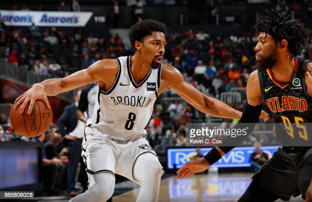Spencer Dinwiddie of the Brooklyn Nets drives against DeAndre' Bembry of the Atlanta Hawks at Philips Arena on December 4 2017 in Atlanta Georgia...