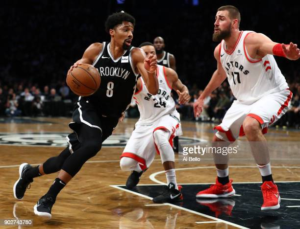 Spencer Dinwiddie of the Brooklyn Nets drives against Jonas Valanciunas of the Toronto Raptors during their game at Barclays Center on January 8 2018...