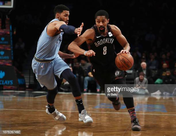 Spencer Dinwiddie of the Brooklyn Nets drives against Wayne Selden of the Memphis Grizzlies during their game at the Barclays Center on November 30...