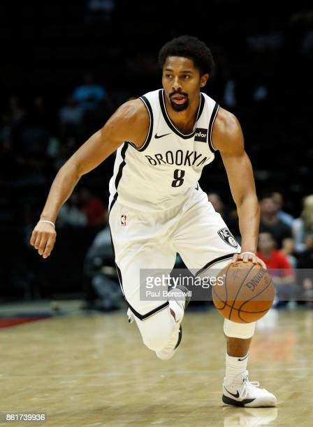 Spencer Dinwiddie of the Brooklyn Nets drives during a preseason NBA basketball game against the Philadelphia 76ers on October 11 2017 at NYCB LIVE...