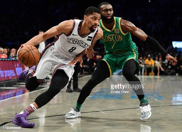 Spencer Dinwiddie of the Brooklyn Nets drives past Jaylen Brown of the Boston Celtics during the second half of their game at Barclays Center on...
