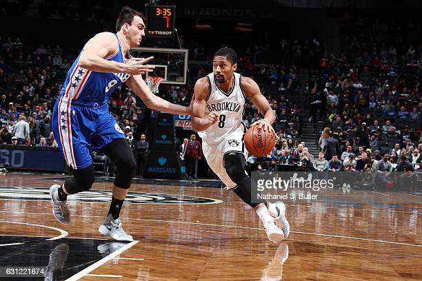 Spencer Dinwiddie of the Brooklyn Nets drives to the basket against Dario Saric of the Philadelphia 76ers during the game on January 8 2017 at...