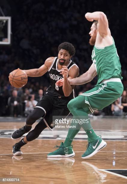 Spencer Dinwiddie of the Brooklyn Nets drives to the basket against Aron Baynes of the Boston Celtics during the second half of the NBA game at...
