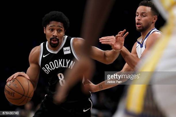 Spencer Dinwiddie of the Brooklyn Nets drives to the basket against Stephen Curry of the Golden State Warriors in the first quarter during their game...