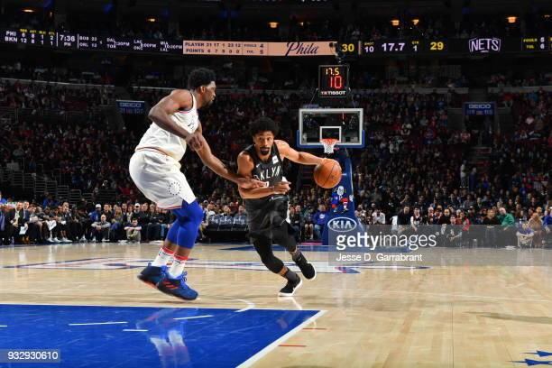 Spencer Dinwiddie of the Brooklyn Nets drives to the basket against the Philadelphia 76ers at the Wells Fargo Center on March 16 2018 in Philadelphia...