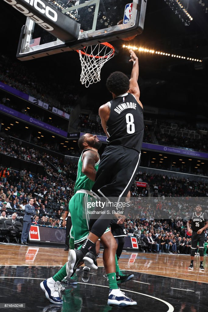 Spencer Dinwiddie #8 of the Brooklyn Nets drives to the basket and shoots the ball against the Boston Celtics on November 14, 2017 at Barclays Center in Brooklyn, New York.