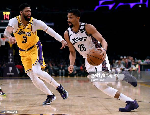 Spencer Dinwiddie of the Brooklyn Nets drives to the basket on Anthony Davis of the Los Angeles Lakers during the first half at Staples Center on...
