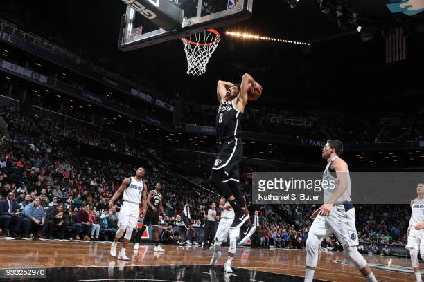 Spencer Dinwiddie of the Brooklyn Nets dunks against the Dallas Mavericks on March 17 2018 at Barclays Center in Brooklyn New York NOTE TO USER User...