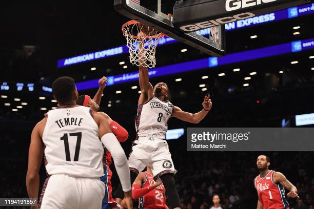 Spencer Dinwiddie of the Brooklyn Nets dunks the ball against Tobias Harris of the Philadelphia 76ers during the game at Barclays Center on December...