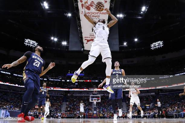 Spencer Dinwiddie of the Brooklyn Nets dunks the ball over Anthony Davis of the New Orleans Pelicans and Nikola Mirotic during the first half at the...