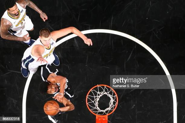 Spencer Dinwiddie of the Brooklyn Nets goes to the basket against the Denver Nuggets on October 29 2017 at Barclays Center in Brooklyn New York NOTE...