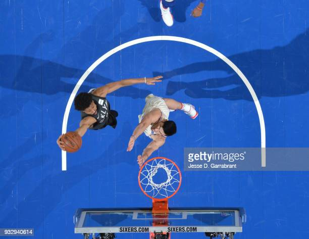 Spencer Dinwiddie of the Brooklyn Nets goes up for the dunk against the Philadelphia 76ers at the Wells Fargo Center on March 16 2018 in Philadelphia...
