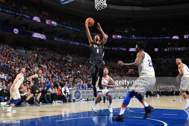 Spencer Dinwiddie of the Brooklyn Nets goes up for the layup against the Philadelphia 76ers at the Wells Fargo Center on March 16 2018 in...