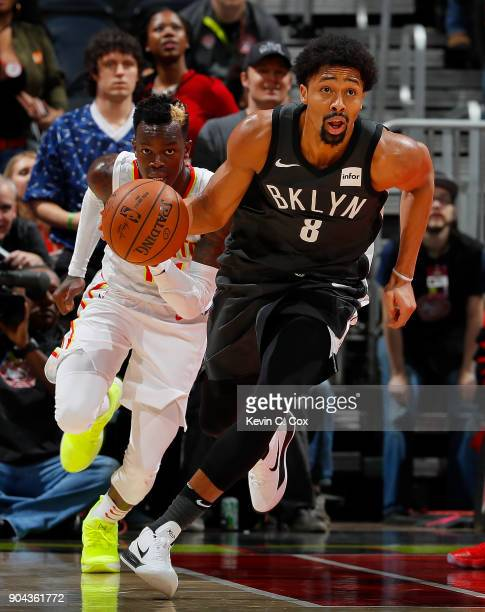 Spencer Dinwiddie of the Brooklyn Nets grabs this defensive rebound against Dennis Schroder of the Atlanta Hawks on the way to scoring the goahead...