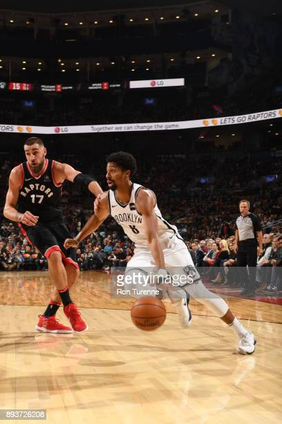 Spencer Dinwiddie of the Brooklyn Nets handles the ball against Jonas Valanciunas of the Toronto Raptorson December 15 2017 at the Air Canada Centre...