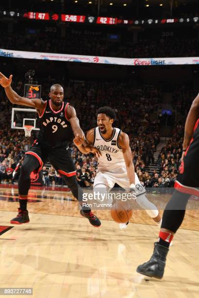 Spencer Dinwiddie of the Brooklyn Nets handles the ball against Serge Ibaka of the Toronto Raptors on December 15 2017 at the Air Canada Centre in...