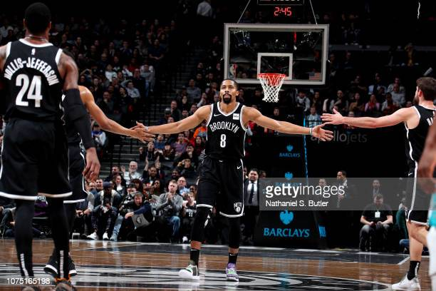Spencer Dinwiddie of the Brooklyn Nets hifives his teammates against the Charlotte Hornets on December 26 2018 at Barclays Center in Brooklyn New...
