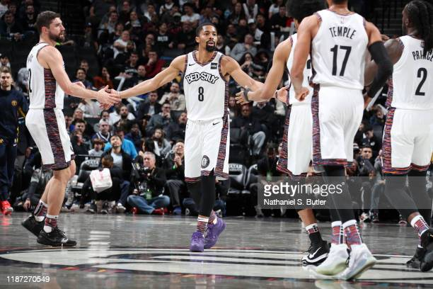 Spencer Dinwiddie of the Brooklyn Nets high fives his teammates during a game against the Denver Nuggets on December 8 2019 at Barclays Center in...