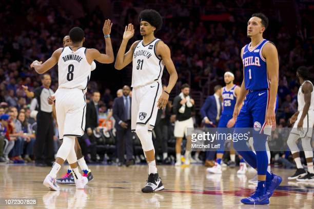 Spencer Dinwiddie of the Brooklyn Nets high fives Jarrett Allen in front of Landry Shamet of the Philadelphia 76ers in the third quarter at the Wells...