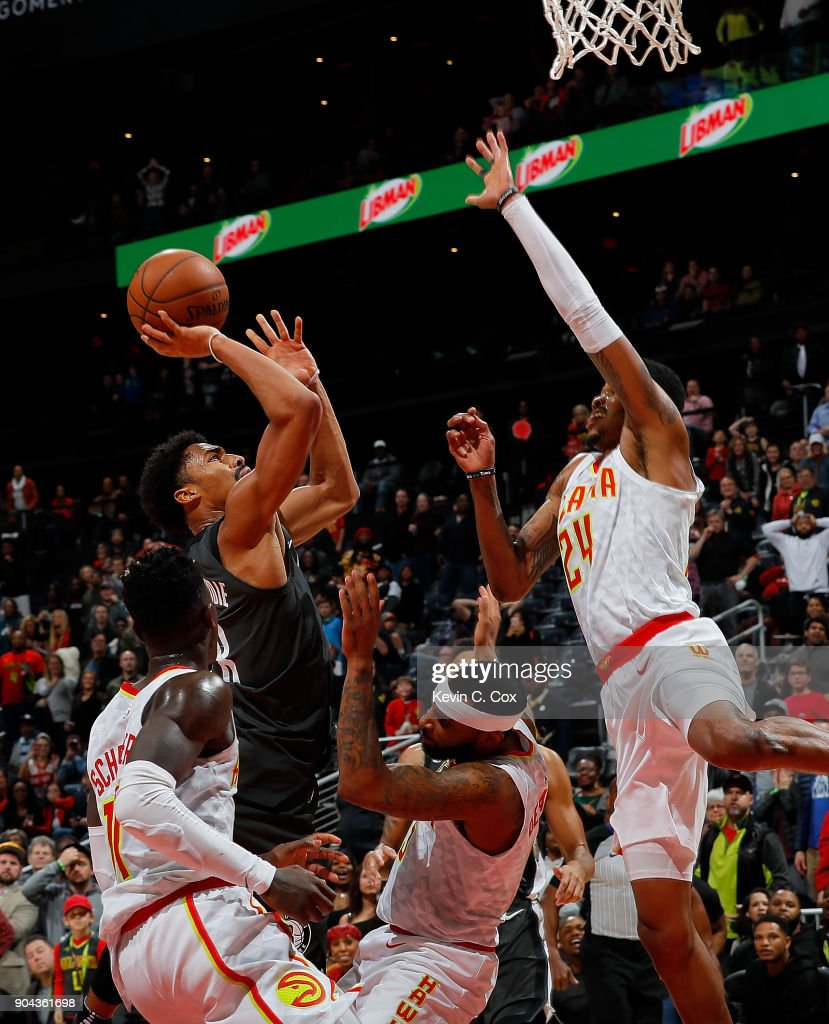 Spencer Dinwiddie #8 of the Brooklyn Nets hits this go-ahead basket in the final seconds as he draws a foul from Malcolm Delaney #5 of the Atlanta Hawks at Philips Arena on January 12, 2018 in Atlanta, Georgia.