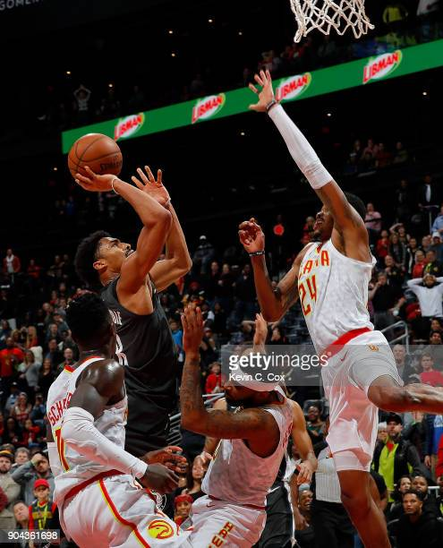 Spencer Dinwiddie of the Brooklyn Nets hits this go-ahead basket in the final seconds as he draws a foul from Malcolm Delaney of the Atlanta Hawks at...