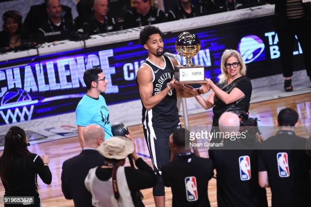 Spencer Dinwiddie of the Brooklyn Nets holds up the trophy after winning the Taco Bell Skills Challenge during State Farm AllStar Saturday Night as...