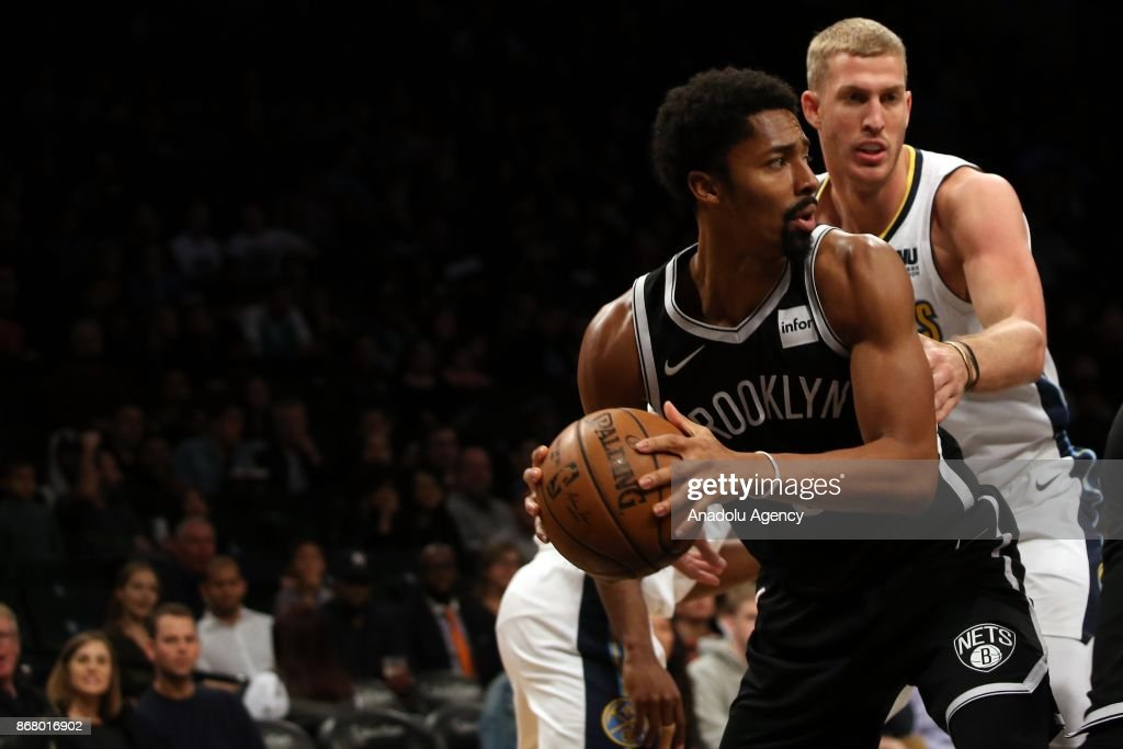 Spencer Dinwiddie (L) of the Brooklyn Nets in action against Mason Plumlee (R) of the Denver Nuggets during NBA basketball match between Denver Nuggets and Brooklyn Nets at Barclays Center in Brooklyn Borough of New York City, United States on October 29, 2017.