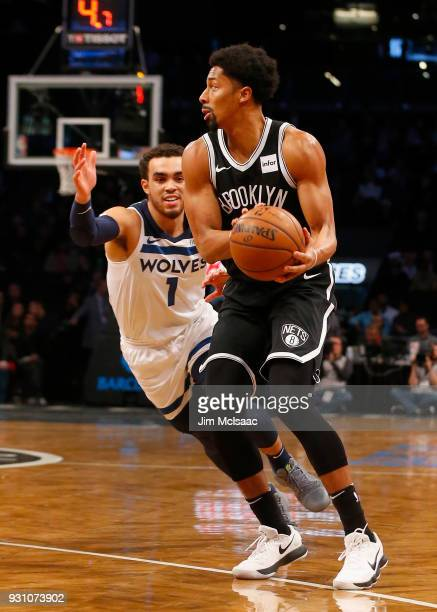 Spencer Dinwiddie of the Brooklyn Nets in action against Tyus Jones of the Minnesota Timberwolves at Barclays Center on January 3 2018 in the...