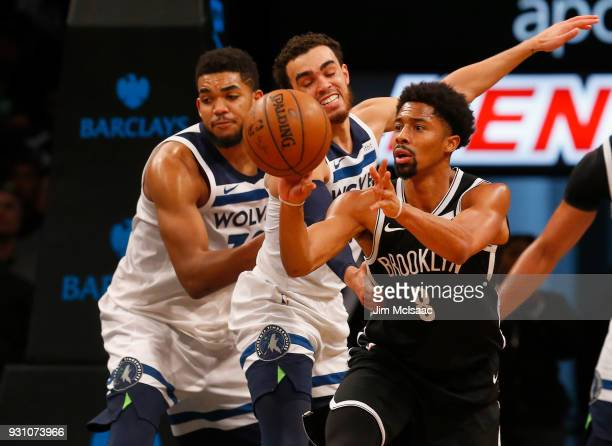 Spencer Dinwiddie of the Brooklyn Nets in action against Tyus Jones and KarlAnthony Towns of the Minnesota Timberwolves at Barclays Center on January...