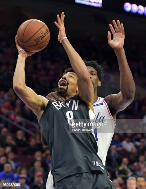 Spencer Dinwiddie of the Brooklyn Nets is fouled by Joel Embiid of the Philadelphia 76ers at the Wells Fargo Center on March 16 2018 in Philadelphia...