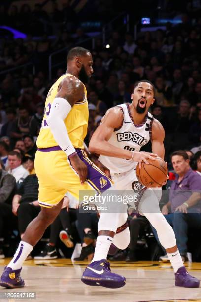 Spencer Dinwiddie of the Brooklyn Nets is fouled by LeBron James of the Los Angeles Lakers during a game at the Staples Center on March 10 2020 in...