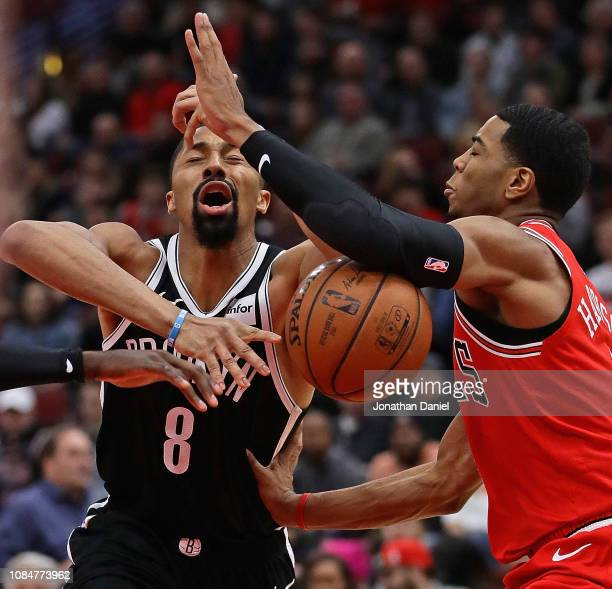 Spencer Dinwiddie of the Brooklyn Nets is fouled by Shaquille Harrison of the Chicago Bulls at the United Center on December 19 2018 in Chicago...