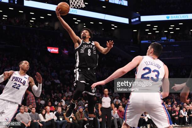 Spencer Dinwiddie of the Brooklyn Nets lays up a shot against Ersan Ilyasova of the Philadelphia 76ers during the game at Barclays Center on March 11...