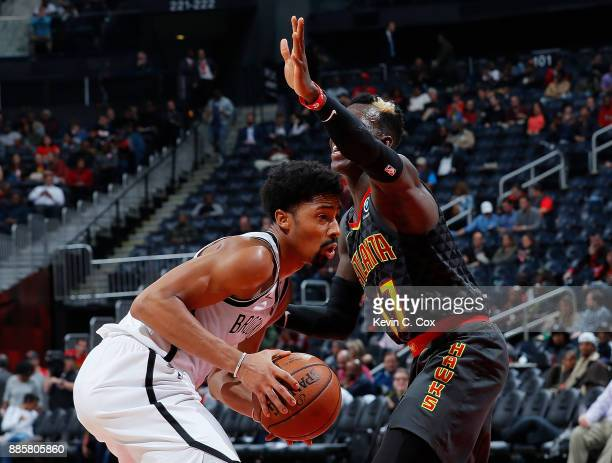 Spencer Dinwiddie of the Brooklyn Nets looks to drives against Dennis Schroder of the Atlanta Hawks at Philips Arena on December 4 2017 in Atlanta...