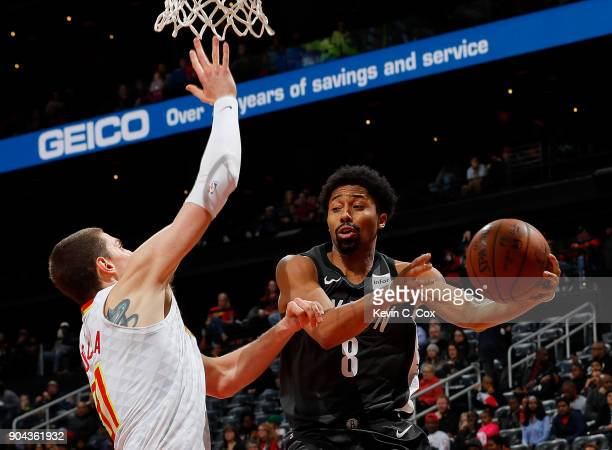 Spencer Dinwiddie of the Brooklyn Nets looks to pass as he drives against Mike Muscala of the Atlanta Hawks at Philips Arena on January 12 2018 in...