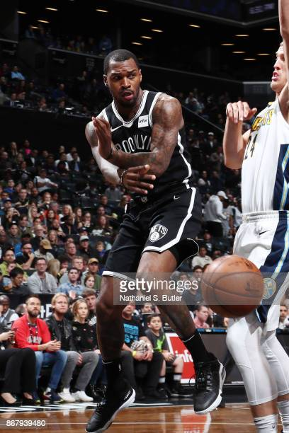 Spencer Dinwiddie of the Brooklyn Nets passes the ball against the Denver Nuggets on October 29 2017 at Barclays Center in Brooklyn New York NOTE TO...