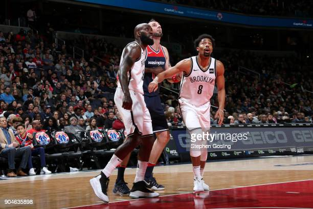 Spencer Dinwiddie of the Brooklyn Nets Quincy Acy of the Brooklyn Nets and Marcin Gortat of the Washington Wizards react to a play during the game on...
