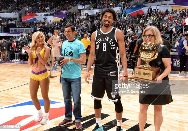 Spencer Dinwiddie of the Brooklyn Nets receives the Champions trophy after the Taco Bell Skills Challenge during State Farm AllStar Saturday Night as...