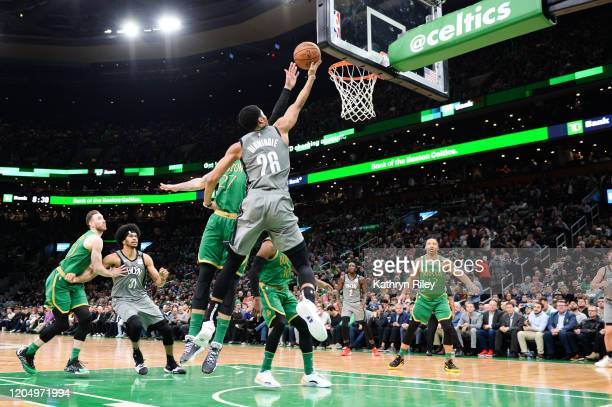 Spencer Dinwiddie of the Brooklyn Nets scores against Daniel Theis of the Boston Celtics in the first half at TD Garden on March 3 2020 in Boston...