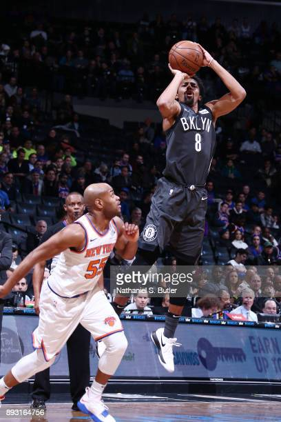 Spencer Dinwiddie of the Brooklyn Nets shoots a 3pointer against the New York Knicks on December 14 2017 at Barclays Center in Brooklyn New York NOTE...