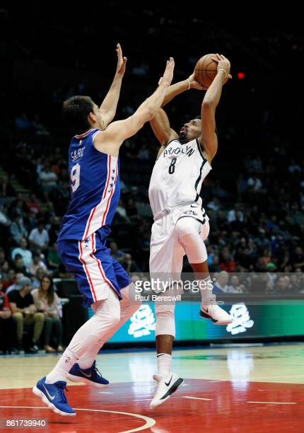 Spencer Dinwiddie of the Brooklyn Nets shoots over Dario Saric of the Philadelphia 76ers during a preseason NBA basketball game on October 11 2017 at...