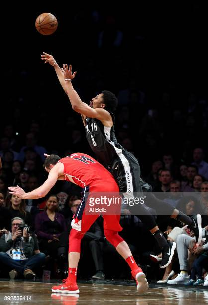 Spencer Dinwiddie of the Brooklyn Nets shoots over Jason Smith of the Washington Wizards during their game at Barclays Center on December 12 2017 in...