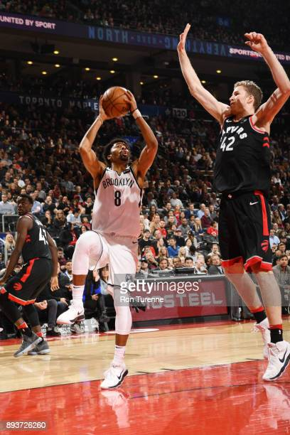 Spencer Dinwiddie of the Brooklyn Nets shoots the ball against Jakob Poeltl of the Toronto Raptors on December 15 2017 at the Air Canada Centre in...