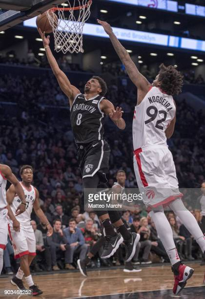 Spencer Dinwiddie of the Brooklyn Nets shoots the ball against Lucas Nogueira of the Toronto Raptors during the game at Barclays Center on January 08...