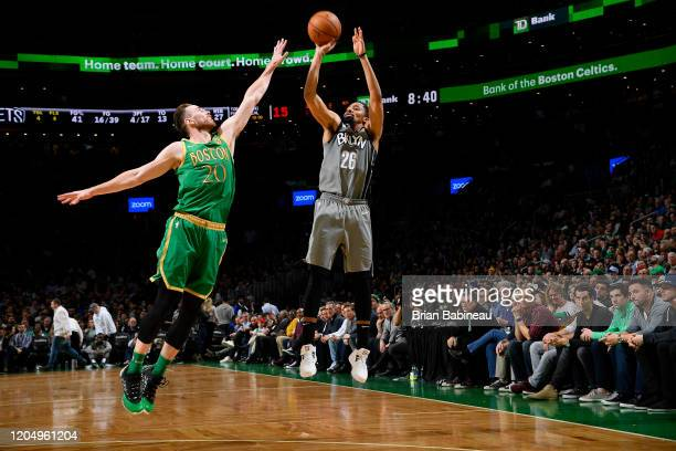 Spencer Dinwiddie of the Brooklyn Nets shoots the ball against the Boston Celtics on March 03 2020 at the TD Garden in Boston Massachusetts NOTE TO...