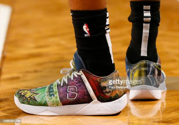 Spencer Dinwiddie of the Brooklyn Nets wears sneakers that honor the late creator of Spiderman and other superheroes artist Stan Lee during an NBA...