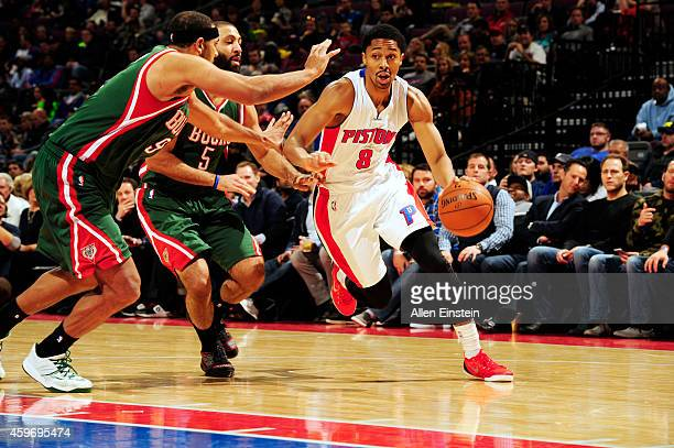 Spencer Dinwiddie of the Detroit Pistons drives to the basket against the Milwaukee Bucks on November 28 2014 at the Palace of Auburn Hills in Auburn...