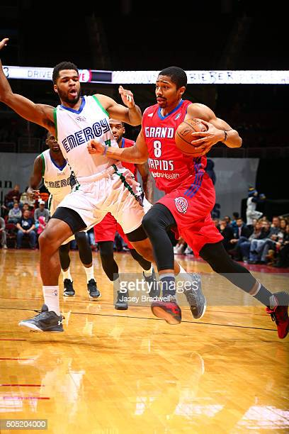 Spencer Dinwiddie of the Grand Rapids Drive drives to the basket around Andrew Harrison of the Iowa Energy in an NBA DLeague game on January 15 2016...