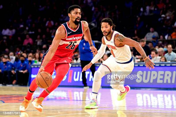 Spencer Dinwiddie of the Washington Wizards drives to the basket against Derrick Rose of the New York Knicks during a preseason game at Madison...