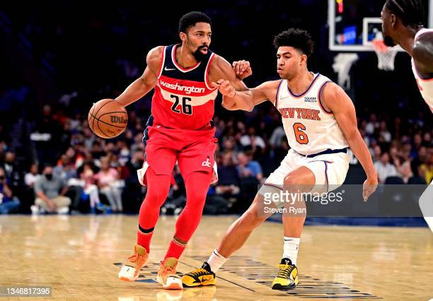 Spencer Dinwiddie of the Washington Wizards is defended by Quentin Grimes of the New York Knicks during a preseason game at Madison Square Garden on...